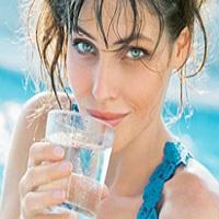 woman enjoying water from alkalizer